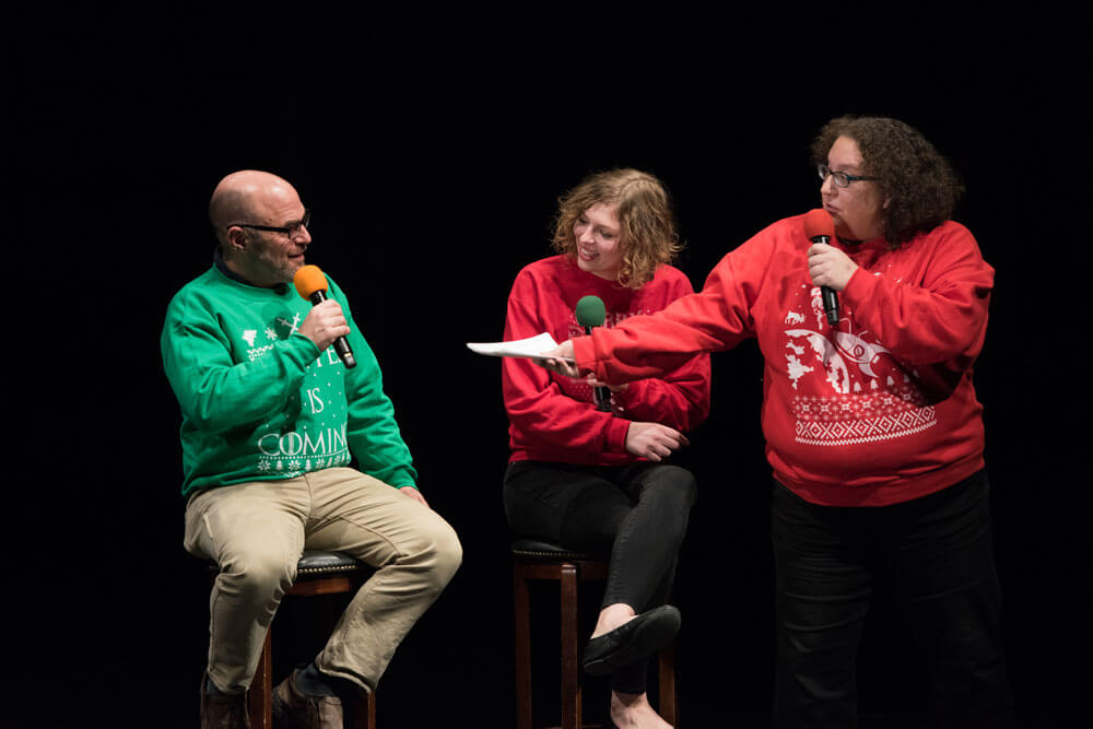 Peter Sagel on stage with Greta Johnson and Tricia Bobeda at Nerdette's Holiday Spectacular